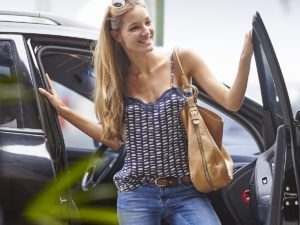 Woman stepping out of car.