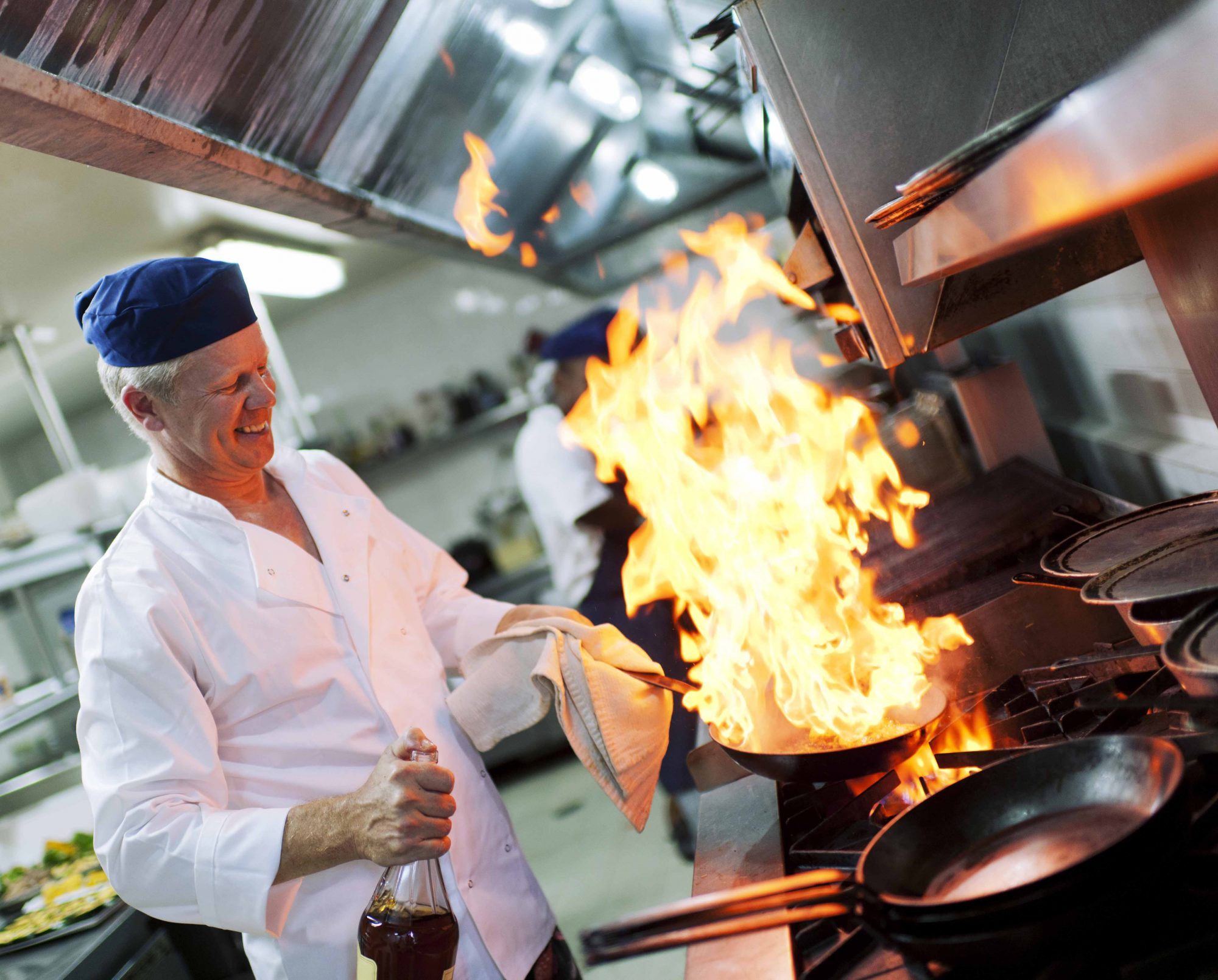 A chef in a commercial kitchen.