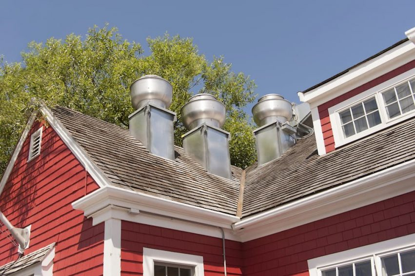 Red bricks house showing kitchen hoods outside